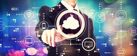 Cloud computing with a businessman on a shiny background
