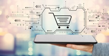 Online shopping theme with man holding a tablet computer