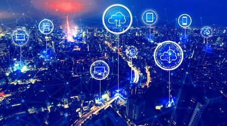 Cloud computing with aerial view of Tokyo, Japan at night