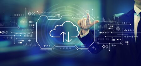 Cloud computing with a businessman in an office Archivio Fotografico