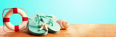Flip flops with buoy on a blue background Stock Photo