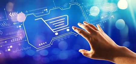 Online shopping theme with hand pressing a button on a technology screen Banque d'images - 125954219