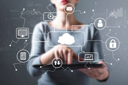 Cloud computing with business woman using a tablet computer