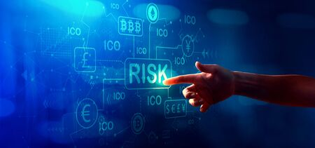 Cryptocurrency ICO risk theme with hand pressing a button on a technology screen
