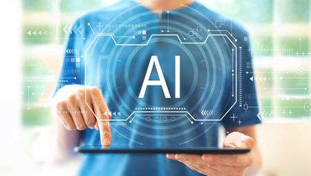 AI concept with young man using a tablet computer Stock fotó