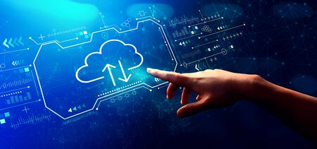 Cloud computing with hand pressing a button on a technology screen