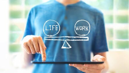 Life and work balance with young man using a tablet computer Stock Photo