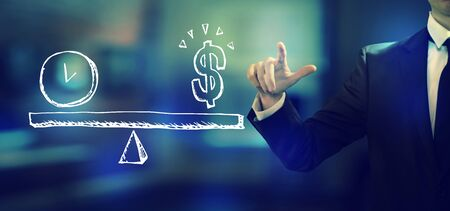Time and money on the scale with a businessman in an office Stock Photo - 126645401