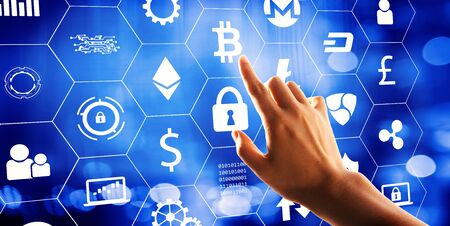 Cryptocurrency with hand pressing a button on a technology screen