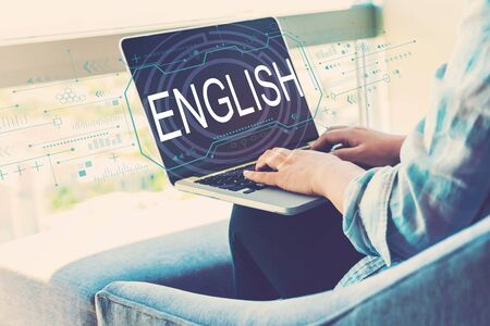 English concept with woman using her laptop in her home office Stock Photo