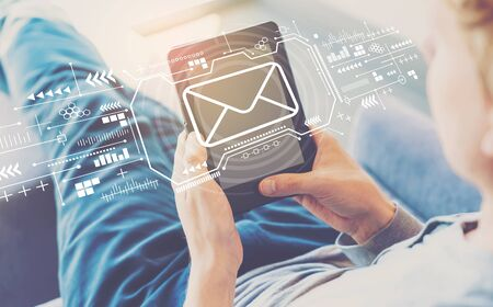 Email with man using a tablet in a chair