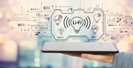 LiFi theme with man holding a tablet computer