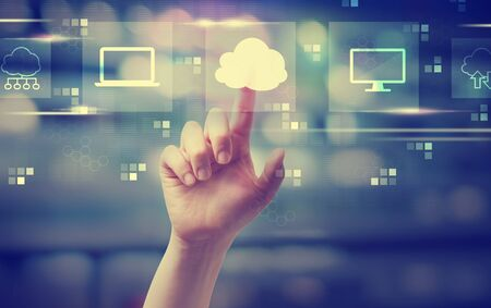 Cloud computing with hand pressing a button at night