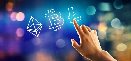 Cryptocurrency - Bitcoin, Ethereum, Litecoin with hand pressing a button on a technology screen