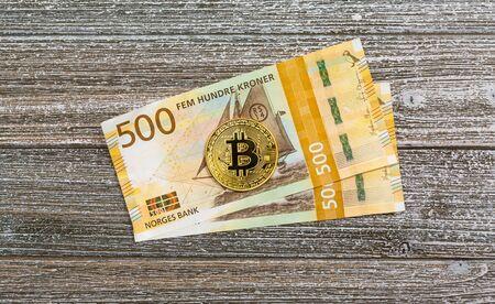 Norwegian kroner bills with Bitcoin cryptocurrency theme