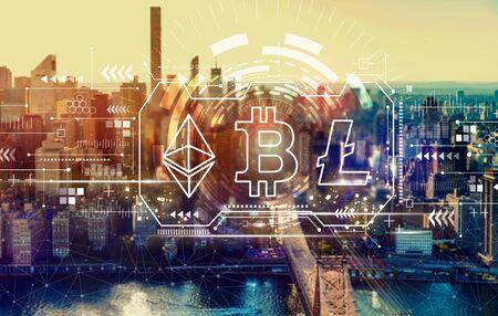 Cryptocurrency - Bitcoin, Ethereum, Litecoin with the New York City skyline near midtown