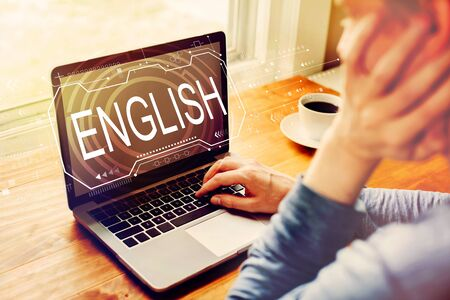 English concept with man using a laptop computer
