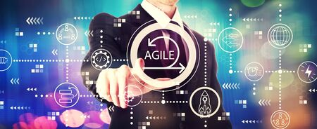 Agile concept with a businessman on a shiny background 写真素材