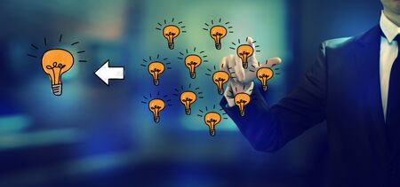 Many small ideas into one big idea with a businessman in an office Stok Fotoğraf