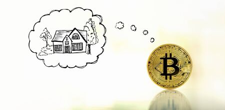 Dreaming of new home with gold bitcoin cryptocurrency coin Foto de archivo - 127936703