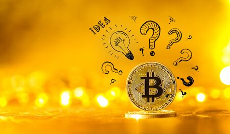 Idea light bulbs with question marks with gold bitcoin cryptocurrency coin Stock Photo