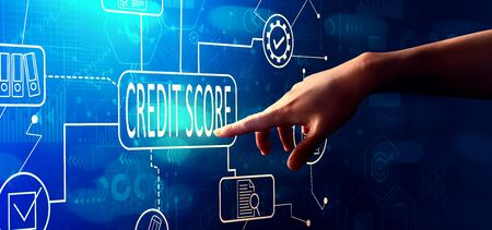 Credit score theme with hand pressing a button on a technology screen