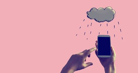 Rain cloud with person holding a white smartphone
