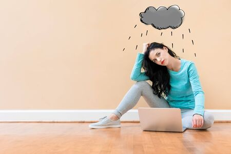 Rain cloud with young woman using a laptop computer