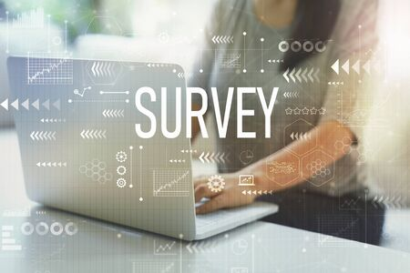 Survey with woman using her laptop in her home office