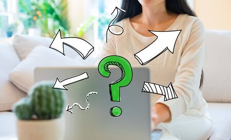Question mark with arrows with woman using her laptop in her home office Фото со стока