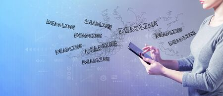 Deadline with business woman using a tablet computer Foto de archivo - 128615926