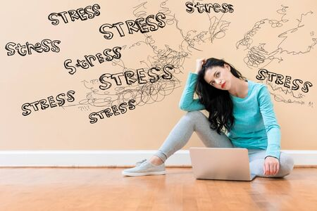 Stress theme with young woman using a laptop computer
