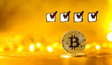 Checklist with a gold bitcoin cryptocurrency coin Reklamní fotografie - 128550037