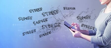 Stress theme with business woman using a tablet computer