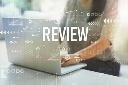 Review with woman using her laptop in her home office