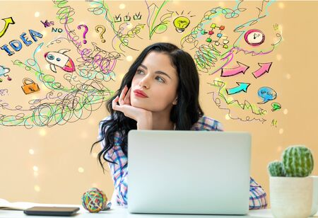Many thoughts with young woman using a laptop Banque d'images - 128758686