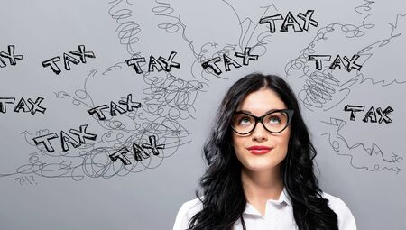 Tax problem theme with young businesswoman in a thoughtful face