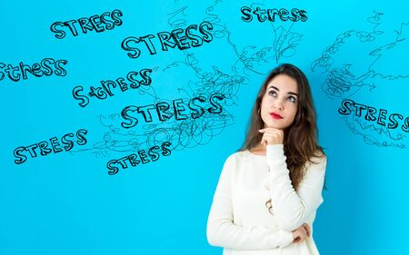 Stress theme with young woman in a thoughtful face Imagens