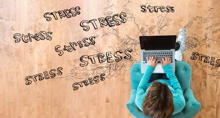 Stress theme with woman using her laptop computer