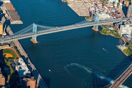 Aerial view of New York City with a view of the Brooklyn and Manhattan Bridges 写真素材 - 129034472