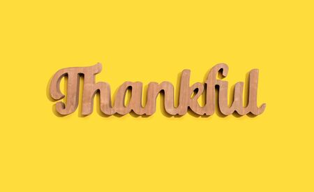 Thankful wooden text from above - overhead view Фото со стока