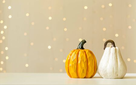 Collection of autumn pumpkins on a shiny light Stock Photo
