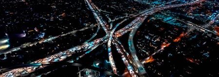 Aerial view of a massive highway in Los Angeles, CA at night Banco de Imagens - 129445072