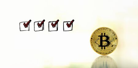 Checklist with a gold bitcoin cryptocurrency coin