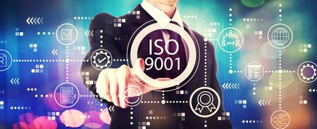 ISO 9001 with a businessman on a shiny background