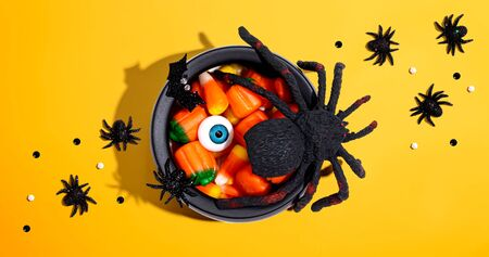 Halloween decorations with witch cauldron - overhead view flat lay