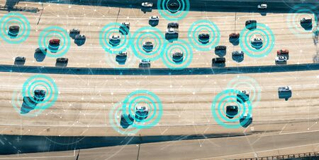Autonomous vehicles driving and communicating on the highway Banco de Imagens