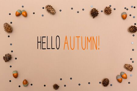 Hello autumn message with autumn themed background border