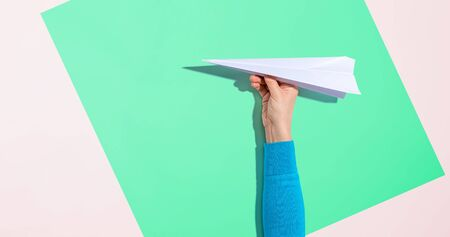 Person holding a paper airplane with hard shadow Stok Fotoğraf