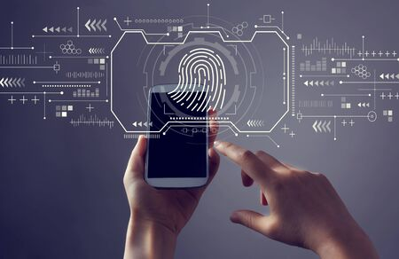 Fingerprint scanning theme with person holding a white smartphone